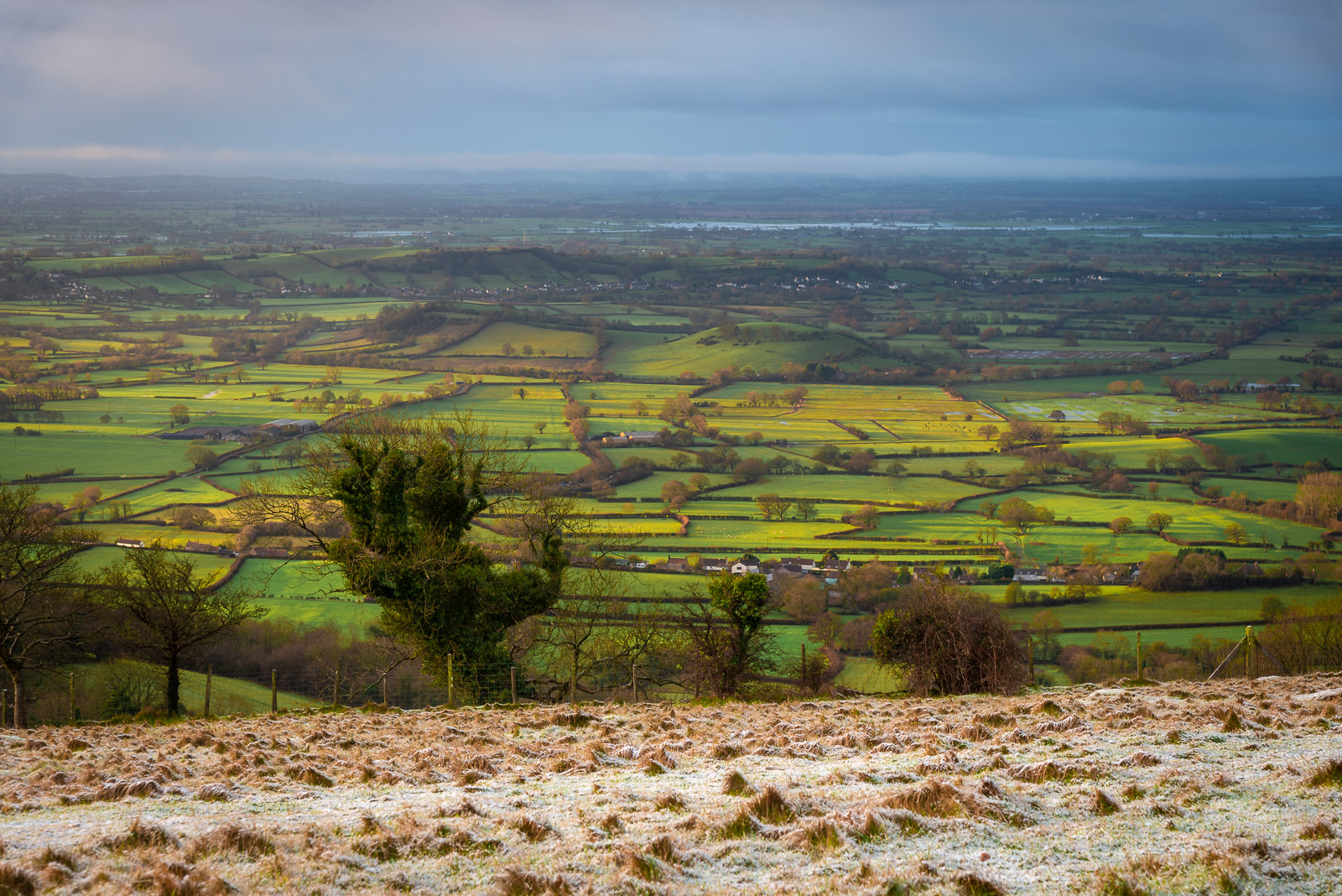 Two Worlds - Somerset Levels from the Mendip Hills, Overlooking Lynchcombe, Somerset, UK. ID JB1_1217H